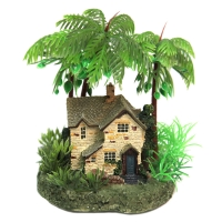 Ornament Cottage With Palm Trees On Rock 10x10x15cm